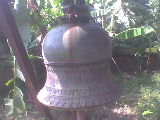 "The Bell in front of ""Shyama"" or ""Marble"" temple"